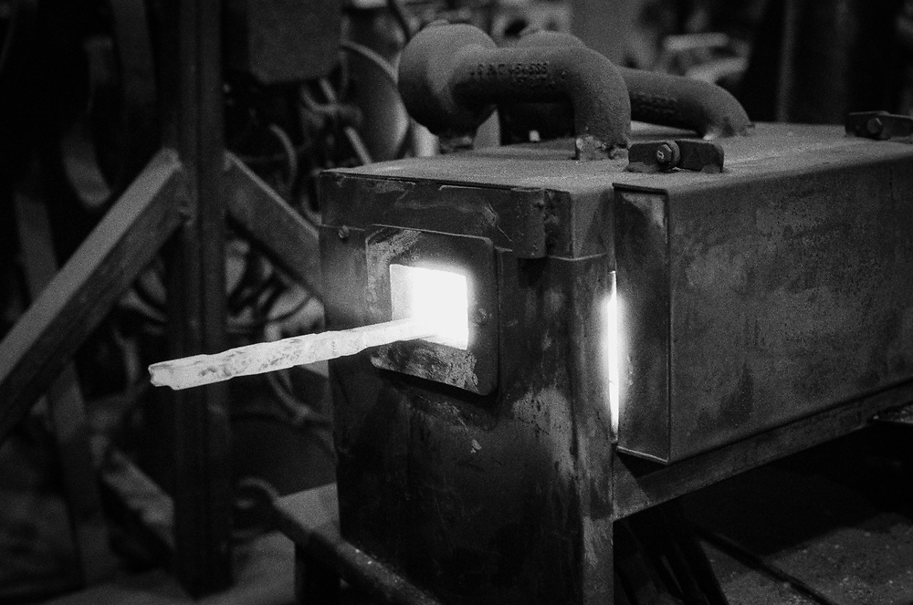 Forging the steel.