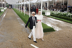 German designer Karl Lagerfeld acknowledges the public at the end of Chanel Fall-Winter 2007-2008 Haute-Couture collection presentation held at 'Parc de Saint-Cloud' near Paris, France on July 3, 2007. Photo by Java/ABACAPRESS.COM