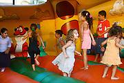 Israel, Netanya, Outdoor, Summer entertainment for children. Children play in a jump house