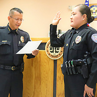 Police Chief Franklin Boyd swears in Erin Toadlena-Pablo as a new  captain at the GPD Friday in this  photo from the Gallup Police Department's Facebook page.