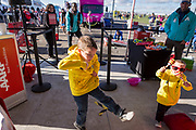 Brothers Colton and Camden Alford dance to the music at the AARP Block Party at the Albuquerque International Balloon Fiesta in Albuquerque New Mexico USA on Oct. 8th, 2018.