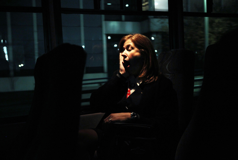American Airlines flight attendant Kristen Heller finally lets herself yawn as the tiredness sets in on the shuttle to the crew's hotel in Minneapolis, Minnesota, October 29, 2010. Her day began in Portland and took her to Dallas, then to Austin, back to Dallas and finally to Minneapolis.  (Courtney Perry/Dallas Morning News/MCT)
