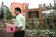 A teacher is walking by the board in the garden of D.A.V. Public School, where Budhia Singh studies, in Bhubaneswar, the capital of Orissa State, on Friday, May 16, 2008. On May 1, 2006, Budhia completed a record breaking 65 km run from Jagannath temple, Puri to Bhubaneswar. He was accompanied by his coach Biranchi Das and by the Central Reserve Police Force (CRPF). On 8th May 2006, a Government statement had ordered that he stopped running. The announcement came after doctors found the boy had high blood pressure and cardiological stress. As of 13th August 2007 Budhia's coach Biranchi Das was arrested by Indian police on suspicion of torture. Singh has accused his coach of beating him and withholding food. Das says Singh's family are making up charges as a result of a few petty rows. On April 13, Biranchi Das was shot dead in Bhubaneswar, in what is believed to be an event unconnected with Budhia, although the police is investigating the case and has made an arrest, a local goon named Raja Archary, which is now in police custody. **Italy and China Out**