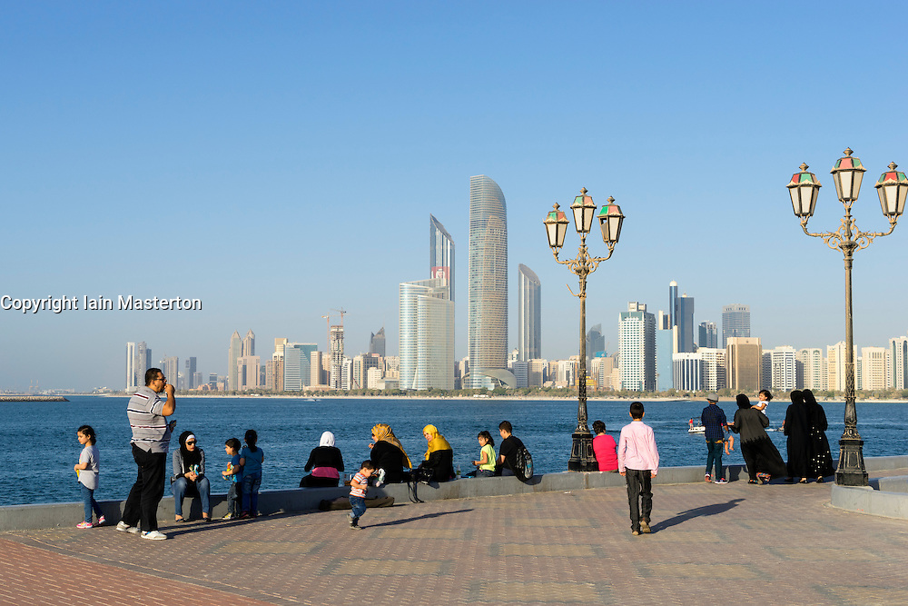 Daytime skyline view and local people in Abu Dhabi in United Arab Emirates