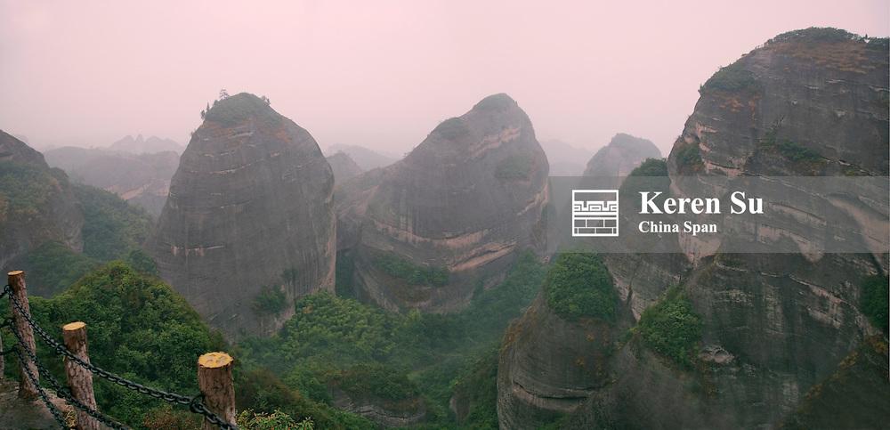 Red Sand Stone Topography, Baijiaozhai (Eight Corner Village) Peak in mist, Guangxi Province, China