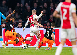 Donny van de Beek #6 of Ajax, Denzel Dumfries #22 of PSV Eindhoven, Nick Viergever #4 of PSV Eindhoven in action during the match between Ajax and PSV at Johan Cruyff Arena on February 02, 2020 in Amsterdam, Netherlands