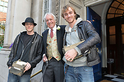JOHN RENDALL and his  sons MAX RENDALL and NICKY RENDALL (wearing hat) at the wedding of Pattie Boyd & Rod Weston  at Chelsea Registry Office, Chelsea Old Town Hall, King's Road, London on 30th April 2015. Pattie Boyd was previously married to both George Harrison and Eric Clapton.
