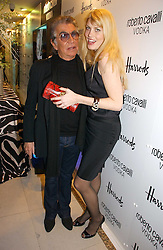ROBERTO CAVALLI and MEREDITH OSTROM at the launch of Roberto Cavalli Vodka held in the International Designer Room, Harrods, Hans Crescent, London on 5th December 2006.<br /><br />NON EXCLUSIVE - WORLD RIGHTS