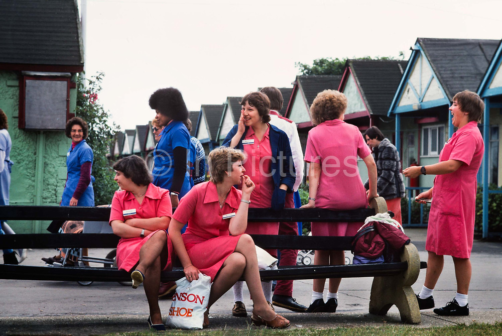 Chambermaids off duty, Butlins Holiday camp, Skegness. Butlins Skegness is a holiday camp located in Ingoldmells near Skegness in Lincolnshire. Sir William Butlin conceived of its creation based on his experiences at a Canadian summer camp in his youth and by observation of the actions of other holiday accommodation providers, both in seaside resort lodging houses and in earlier smaller holiday campsThe camp began opened in 1936, when it quickly proved to be a success with a need for expansion. The camp included dining and recreation facilities, such as dance halls and sports fields. Over the past 75 years the camp has seen continuous use and development, in the mid-1980s and again in the late 1990s being subject to substantial investment and redevelopment. In the late 1990s the site was re-branded as a holiday resort, and remains open today as one of three remaining Butlins resorts.