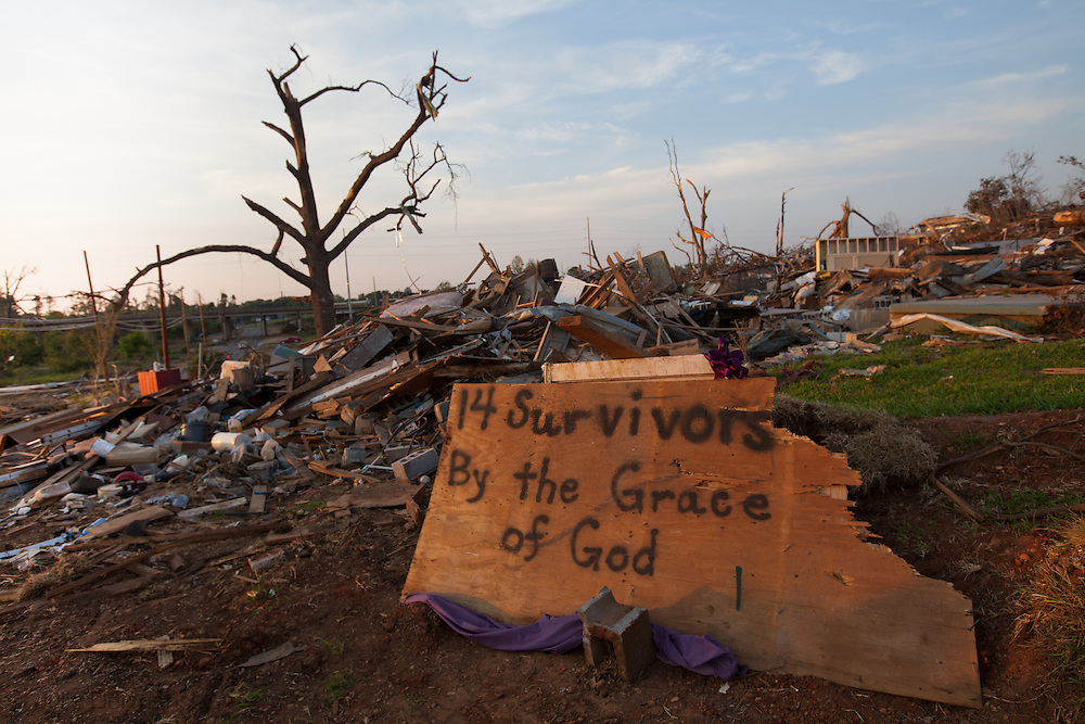 Sign in front of Destoryed homes in Tuscaloosa Alabama after being hit by a tornado  . Tuscaloosa was hit by  F-4 and  possibly  F-5 tornados that were part of a storm  of an estimated 300 that struck Alabama and the neighboring states on April 27th , 2011.
