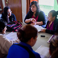 051415       Cable Hoover<br /> <br /> Erika Prendas, center, reads aloud for a study group during a Spanish Language social studies course Thursday at the New Life Learning Center in Gamerco.