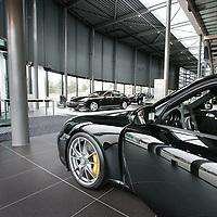 Nederland, Amsterdam , 15 september 2009..Ron Loenen in zijn nieuwe showroom van Porsche..Foto:Jean-Pierre Jans.Ron Loenen in his new Porsche showroom.