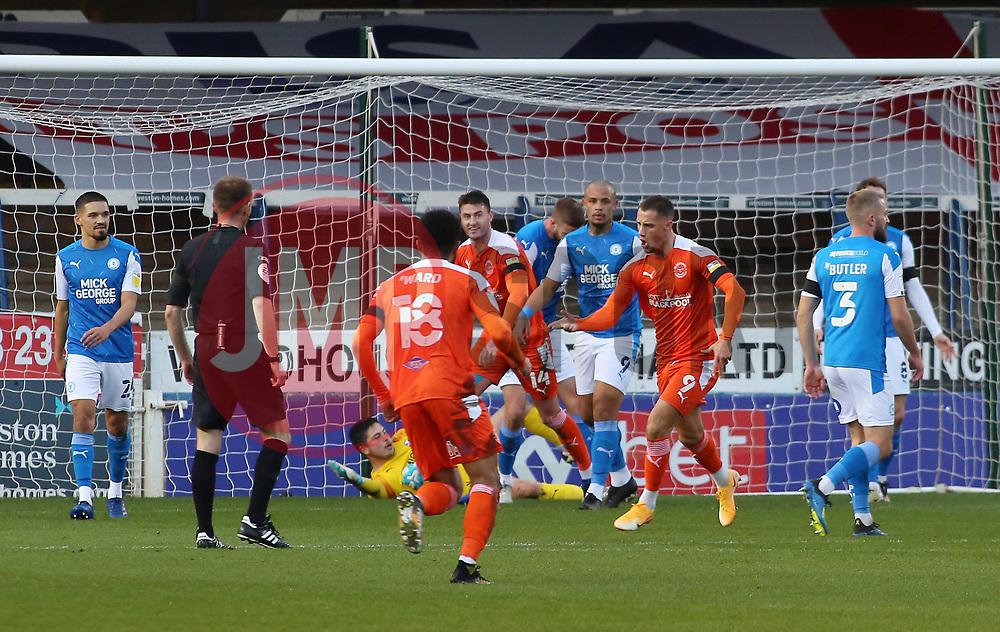 Jerry Yates of Blackpool (number 9) celebrates scoring the opening goal - Mandatory by-line: Joe Dent/JMP - 21/11/2020 - FOOTBALL - Weston Homes Stadium - Peterborough, England - Peterborough United v Blackpool - Sky Bet League One