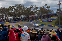 October 8, 2018 - Bathurst, NSW, U.S. - BATHURST, NSW - OCTOBER 07: The crowd across the top of the mountain watch as Tim Blanchard in the Team CoolDrive Holden Commodore  and Jamie Whincup in the Red Bull Holden Racing Team Holden Commodore drive past during the Supercheap Auto Bathurst 1000 V8 Supercar Race at Mount Panorama Circuit in Bathurst, Australia on October 07, 2018 (Photo by Speed Media/Icon Sportswire) (Credit Image: © Speed Media/Icon SMI via ZUMA Press)