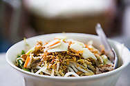 """Traditional vietnamese dish """"bun bo nam bo"""", a vermicelli based dish with fried beef, fried onions, beansprouts and herbs . Hanoi, Vietnam, Southeast Asia"""