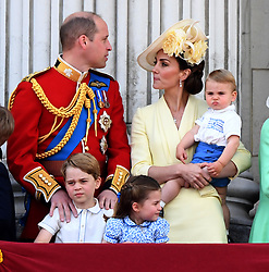 Prince William, Duke of Cambridge, Catherine, Duchess of Cambridge, Prince Louis of Cambridge, Prince George of Cambridge and Princess Charlotte of Cambridge stand on the balcony of Buckingham Palace following Trooping the Colour in London
