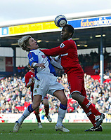 Photo: Andrew Unwin.<br />Blackburn Rovers v Middlesbrough. The Barclays Premiership. 18/03/2006.<br />Middlesbrough's Ugo Ehiogu (R) competes with Blackburn's  Robbie Savage.