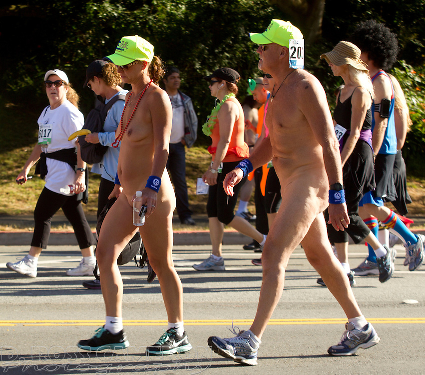 A naked couple walk through Golden Gate Park during the 102nd running of the Bay to Breakers 12K in San Francisco, Sunday, May 19, 2013. More than 30,000 runners -- from the elite to the weekend warrior -- made the 7.62-mile trek from Howard and Spear to the Great Highway. (Photo by D. Ross Cameron)