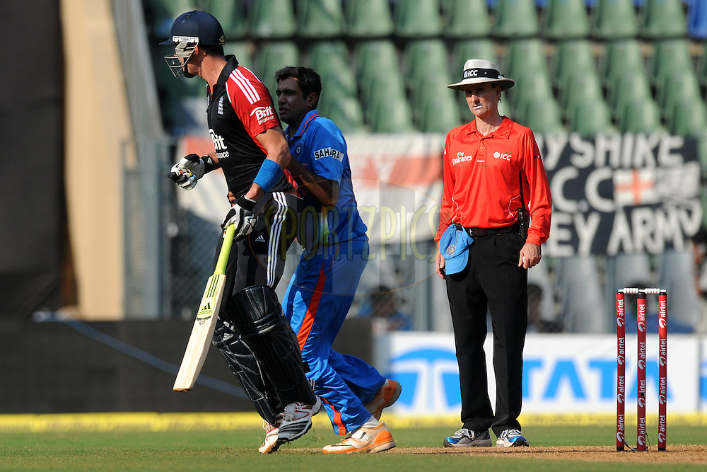 Ravichandran Ashwin of India collides with Kevin Pietersen of England as he tries to stop a ball during the 4th One Day International ( ODI ) match between India and England held at the Wankhede Stadium, Mumbai on the 23rd October 2011..Photo by Pal Pillai/BCCI/SPORTZPICS