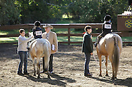 Middletown, NY - A judge talks to a young rider at the Middletown Rotary Horse Show at Fancher-Davidge Park on Sunday, Sept. 20, 2009.