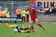 Scunthorpe United Forward, Stephen Humphrys (10) ands Accrington Stanley Defender On loan from Blackpool, Nick Anderton (24) during the EFL Sky Bet League 1 match between Accrington Stanley and Scunthorpe United at the Fraser Eagle Stadium, Accrington, England on 1 September 2018.