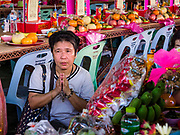 18 SEPTEMBER 2017 - BANGKOK, THAILAND: A woman prays at her family altar at Wat Mangkon Kamalawat, a Chinese temple in Bangkok, during a service to mark the last day Hungry Ghost Month. The Ghost Festival, also known as the Hungry Ghost Festival, Zhongyuan Festival or Yulan Festival is a traditional Buddhist and Taoist festival held in Asian countries. According to the Chinese calendar (a lunisolar calendar), the Ghost Festival is on the 15th night of the seventh month. In Chinese culture, the fifteenth day of the seventh month in the lunar calendar is called Ghost Day and the seventh month in general is regarded as the Ghost Month, in which ghosts and spirits, including those of the deceased ancestors, come out from the lower realm. Distinct from both the Qingming Festival (in spring) and Double Ninth Festival (in autumn) in which living descendants pay homage to their deceased ancestors, during Ghost Festival, the deceased are believed to visit the living.     PHOTO BY JACK KURTZ