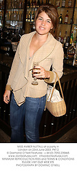 MISS AMBER NUTTALL at a party in London on 23rd June 2003.PKT 2