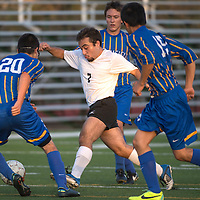 Gallup Bengal Daniel Lopez (7) dribbles the ball past three Bloomfield Bobcats during the game held at Publigh School Stadium in Gallup Tuesday.
