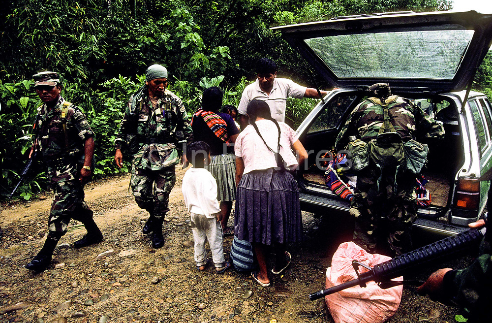 Special police squadron known as UMOPAR stop and search cars and buses in the hope of catching small time traffickers of coca leaf paste in the Chaparé jungle region, Bolivia