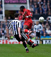 Photo. Glyn Thomas.<br /> Newcastle United v Middlesbrough. Premiership.<br /> St James' Park, Newcastle. 21/02/2004.<br /> Boro's Joseph Job (R) comes in with a late challenge on Andy O'Brien, which sparked a row with the referee as he wasn't shown the red card.