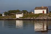 Flåvær is a small group of islets and rocks in Herøyfjord in the municipality Herøy, located in the county Sunnmøre at the west coast of Norway. It includes the island Flåvær, Husholmen, Torvholmen and Varholmen. The archipelago was inhabited until the mid 1980's. Here you see the old schoolhouse  <br /> Flåvær er en liten gruppe med holmer og skjær i Herøyfjorden i Herøy på Sunnmøre, og omfatter holmene Flåvær, Husholmen, Torvholmen og Varholmen. Øygruppa var bebodd til midt på 1980 tallet. Her ser dere det gamle skolehuset.