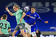 Brighton and Hove Albion midfielder Jakub Moder (15) battles for a header with Everton midfielder Tom Davies (26) during the Premier League match between Brighton and Hove Albion and Everton at the American Express Community Stadium, Brighton and Hove, England UK on 12 April 2021.