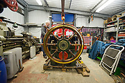 ****COPY HERE****  (https://www.dropbox.com/s/5mg81qiiuy22tre/adamson.rtf?dl=0)   © Licensed to London News Pictures. 02/12/2014. Liverpool , UK . Volunteer Graham Dean works in the workshop containing the retired wheel and steering mechanism. The only surviving steam powered tug tender, the Daniel Adamson, is being completely renovated by a team of volunteers in Liverpool. The vessel, which has had 90,000 man hours already spent on it, was bought for only one pound is the awaiting the decision of the Heritage Lottery Fund on an application of £3.6m to bring her back to her full glory.  . Photo credit : Stephen Simpson/LNP<br /> <br /> COPY HERE https://www.dropbox.com/s/5mg81qiiuy22tre/adamson.rtf?dl=0