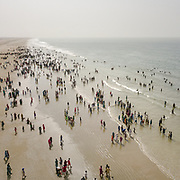 After days travelling from the Thar desert region (near the border with India), Hindu pilgrims come to pay their respect to the Ocean (the Arabian Sea) before heading to the shrine. Many of them see the ocean for the first time.