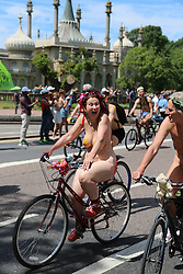 © Licensed to London News Pictures. 08/06/2014. Brighton, UK. Semi Dressed and fully nude participants during the Brighton Naked Bike Ride 2014. Members of the public staging a protest against Oil Dependency and Car Culture. The Naked Bike Ride is part of the National Bike week and the 2014 event is the ninth time the protest has been held in Brighton. Worldwide thousands of riders participate in 50+ cities including around 3000 in the UK along each year.. Photo credit : Hugo Michiels/LNP