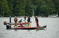 High School anglers keep their lines in the water as they make their way to the docks for weigh in during the NHIAA State Bass Fishing qualifier out of Center Harbor Beach on Thursday.  (Karen Bobotas/for the Laconia Daily Sun)