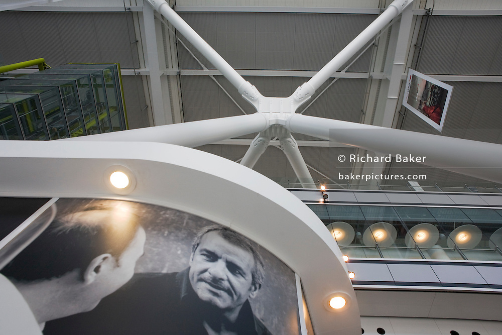 One of Arup's 'torso nodes' engineering roof support strut and advertising image in Heathrow Airport's Terminal 5.