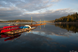 North America, United States, Washington, long dock with red kayaks on Hood Canal