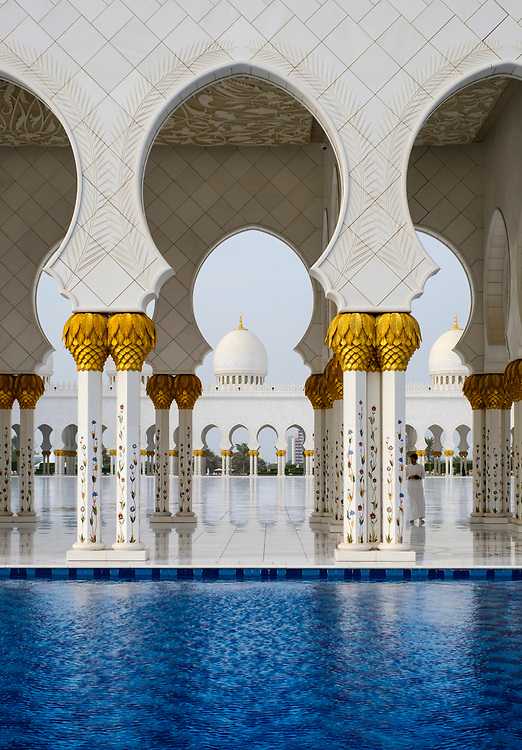 UNITED ARAB EMIRATES, ABU DHABI - CIRCA JANUARY 2017:  Pool, arches and columns of the Sheikh Zayed Mosque
