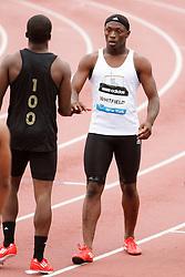 Boys Dream 100 meters, post race Whitfield (winner) congratulates competitor