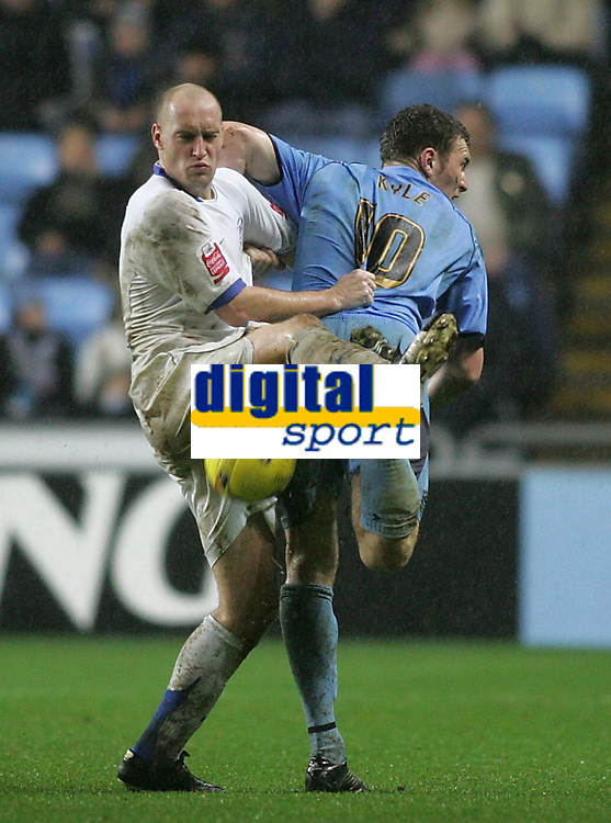Photo: Lee Earle.<br /> Coventry City v Southend United. Coca Cola Championship. 30/12/2006. Southend's Adam Barrett (L) clashes with Kevin Kyle.