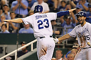 Kansas City Royals' Elliot Johnson (23) and Eric Hosmer (35) react after Johnson scores from third base during the 8th inning of their baseball game against the Tampa Bay Rays at Kauffman Stadium in Kansas City, Mo., Tuesday, April 30, 2013. The Royals defeated the Rays 8-2.  (AP Photo/Colin E. Braley).