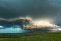Sometimes I chase storms, and other times storms chase me. This beast rolled out of the Little Belt Mountains at 5PM and roared onto the Central Montana plains. It was a challenge to keep up with as it felt like I was never more than a few minutes ahead. The rollings hills provide limited spots to overlook the storm and I couldn't shoot any time lapses because there simply wasn't enough time. I tried to stay to the south of the tornado-warned portion of the storm so I wouldn't be in harm's way. While shooting this picture a rancher stopped by and I asked him if he'd ever seen anything like this. He said he had; apparently sights like this are not uncommon around here in the summer. Big Sky Country certainly lives up to its name. The central part of the state is filled with numerous island mountain ranges, and this shelf cloud swallowed them up like they were nothing.