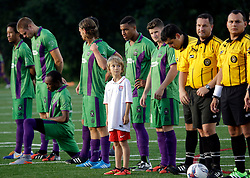 20 June 2015. New Orleans, Louisiana.<br /> National Premier Soccer League. NPSL. <br /> Jesters 1 - Knoxville 1.<br /> Amos Liles gets to walk out with the The New Orleans Jesters before the game against Knoxville Force at home in the Pan American Stadium. Jesters drew 1-1 with Knoxville.<br /> Photo; Charlie Varley/varleypix.com