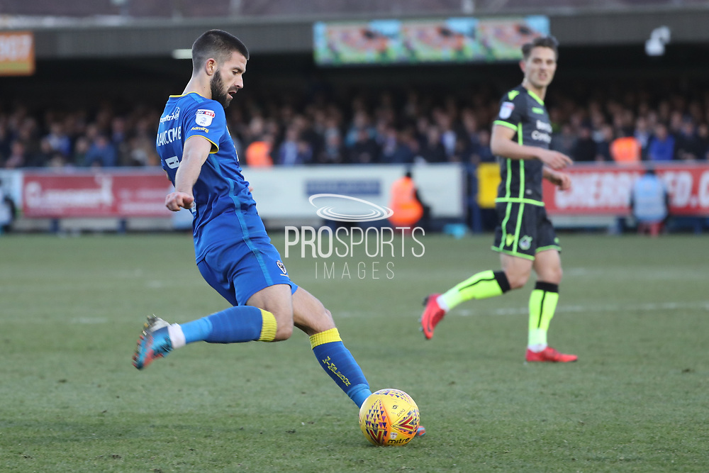 AFC Wimbledon defender George Francomb (7) crossing the ball during the EFL Sky Bet League 1 match between AFC Wimbledon and Bristol Rovers at the Cherry Red Records Stadium, Kingston, England on 17 February 2018. Picture by Matthew Redman.