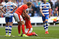 Michael Hefele of Huddersfield Town lifts up Elias Kachunga of Huddersfield Town after the final whistle. EFL Skybet  championship match, Reading  v Huddersfield Town at The Madejski Stadium in Reading, Berkshire on Saturday 24th September 2016.<br /> pic by John Patrick Fletcher, Andrew Orchard sports photography.
