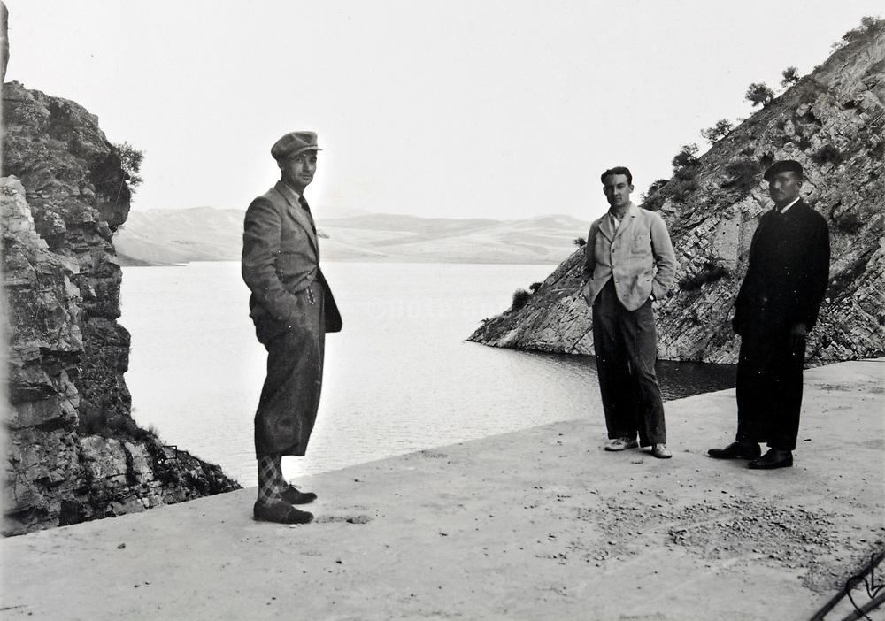 three man posing on dam by mountain lake reservoir Morocco 1930s