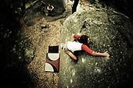 A rock climber climbs at Skofield Park bouldering area, Santa Barbara, California. (releasecode: jk_mr1019, jk_mr1021, jk_mr1017) (Model Released)