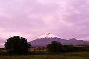 Ecuador, May 26 2010: View of Volcano Cotapaxi during sunset from the grounds of Hacienda San Agustin del Callo. Copyright 2010 Peter Horrell