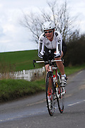 United Kingdom, Finchingfield, Mar 27, 2010:  Tonya Lara Antonis,  East Anglian VTTA, approaches the 4 miles to go marker during the 2010 edition of the 'Jim Perrin' Memorial Hardriders 25.5 mile Sporting TT promoted by Chelmer Cycling Club. Copyright 2010 Peter Horrell.